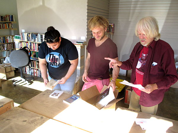 Dr. Hubbard and volunteers packing books for inmates